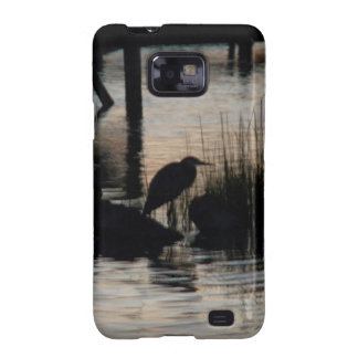 Heron Silhouetted on water at sunset Samsung Galaxy SII Cases