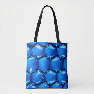 Hexagonal bubble texture background in blue tote bag