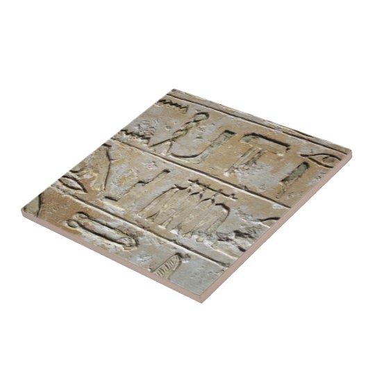 Hieroglyphics on a stone wall small square tile