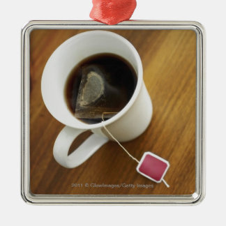 High angle view of a cup of tea christmas ornament