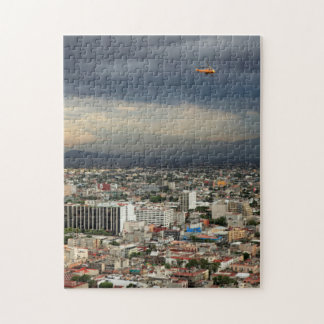 High Angle View Of Cityscape Against Cloudy Sky Jigsaw Puzzle