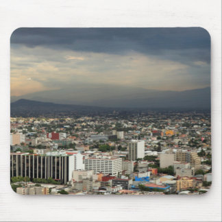 High Angle View Of Cityscape Against Cloudy Sky Mouse Mat