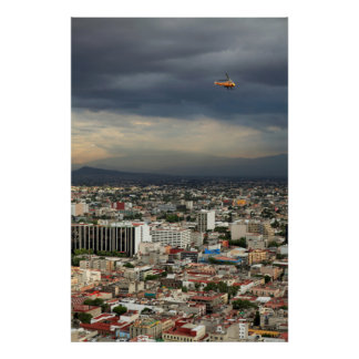 High Angle View Of Cityscape Against Cloudy Sky Poster