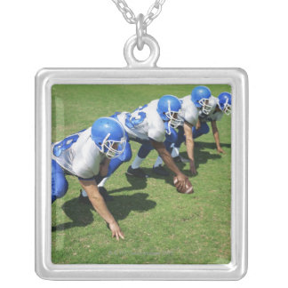 high angle view of four football players playing silver plated necklace