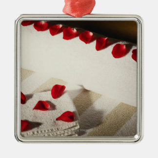 High angle view of rose petals on towels christmas ornament