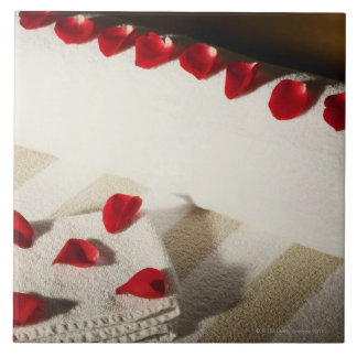 High angle view of rose petals on towels tile