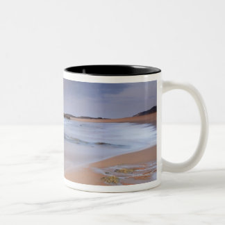 High angle view of shoreline rocks at dawn and Two-Tone coffee mug