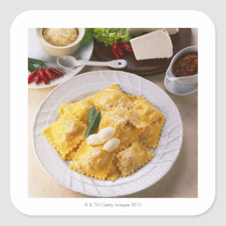 high angle view of stuffed ravioli served with square sticker