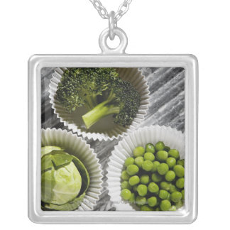 High angle view of vegetables in paper cups silver plated necklace