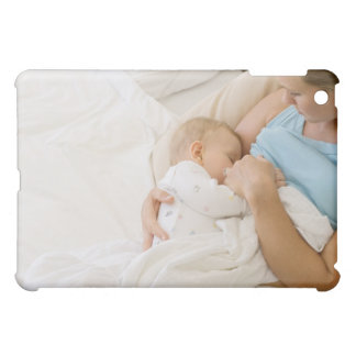 High angle view of woman breastfeeding baby case for the iPad mini