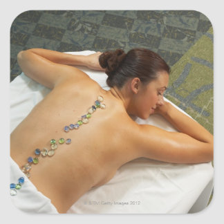 High angle view of woman receiving hot stone square sticker