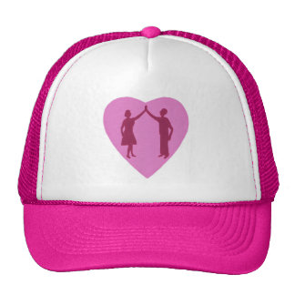 High five, male and female silhouette in a heart trucker hat