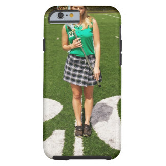 High school lacrosse player (16-18) holding tough iPhone 6 case