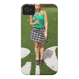 High school lacrosse player (16-18) holding iPhone 4 Case-Mate case