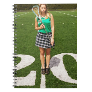 High school lacrosse player (16-18) holding notebooks