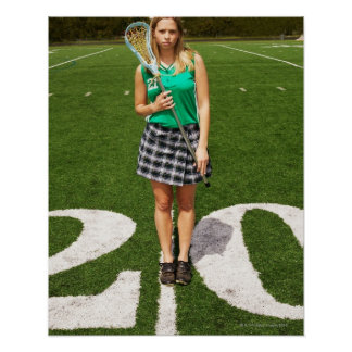 High school lacrosse player (16-18) holding poster
