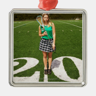 High school lacrosse player (16-18) holding Silver-Colored square decoration