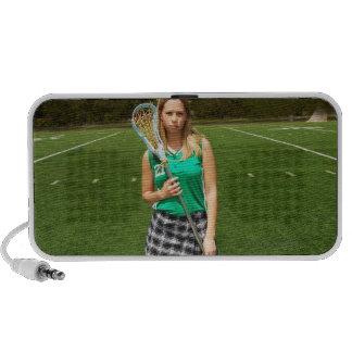High school lacrosse player (16-18) holding travelling speaker