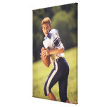 High school quarterback with football canvas prints