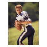 High school quarterback with football card