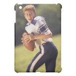 High school quarterback with football iPad mini cases