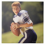 High school quarterback with football large square tile