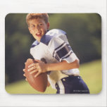 High school quarterback with football mouse pad