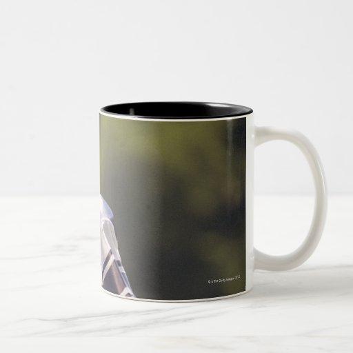 High school quarterback with football Two-Tone coffee mug