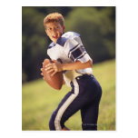 High school quarterback with football postcards