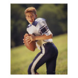 High school quarterback with football poster
