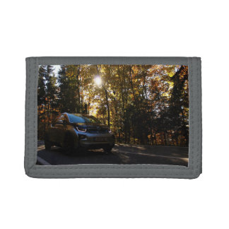 Highway Themed, A Hybrid Car On A Highway Passing Tri-fold Wallets