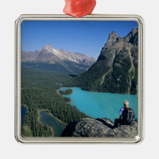 Hiker overlooking turquoise-colored Lake Christmas Ornament