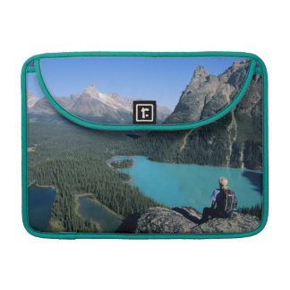 Hiker overlooking turquoise-colored Lake MacBook Pro Sleeves