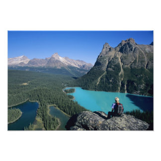 Hiker overlooking turquoise-colored Lake Photo Print