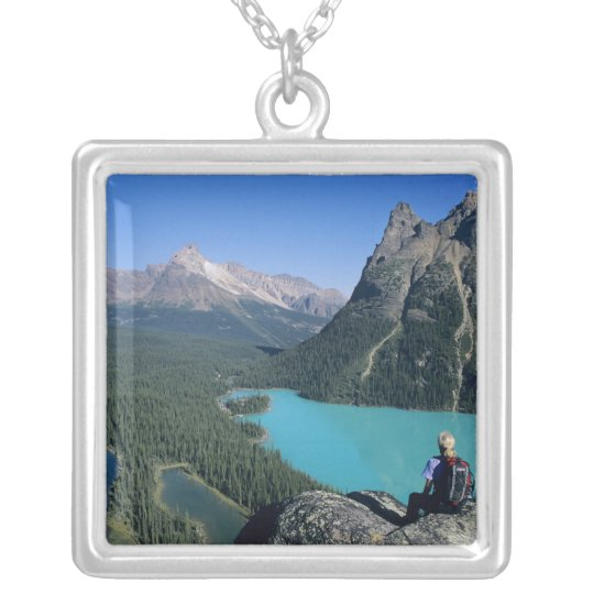Hiker overlooking turquoise-coloured Lake Silver Plated Necklace