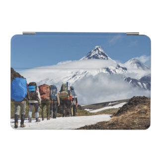 Hikers climbing on mount on background volcanoes iPad mini cover