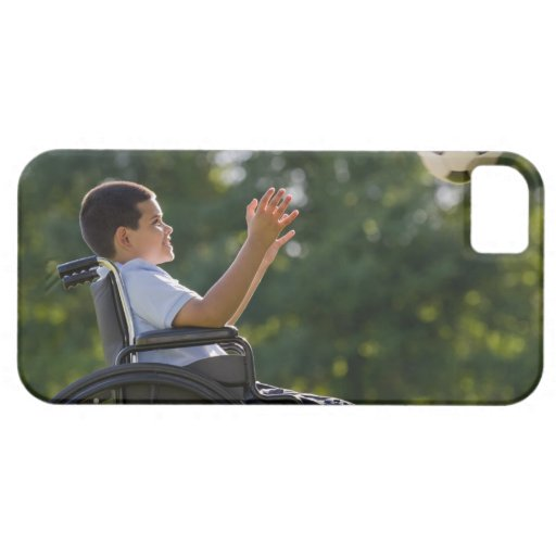 Hispanic boy, 8, in wheelchair with soccer ball iPhone 5 cover