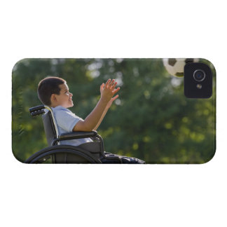 Hispanic boy, 8, in wheelchair with soccer ball iPhone 4 cover