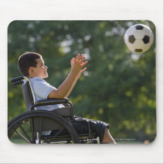 Hispanic boy, 8, in wheelchair with soccer ball mouse mat