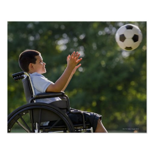 Hispanic boy, 8, in wheelchair with soccer ball poster