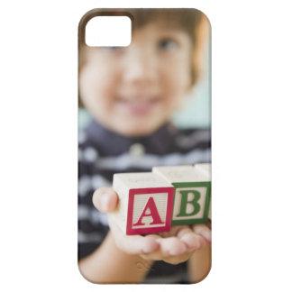 Hispanic boy holding alphabet blocks case for the iPhone 5