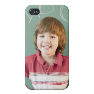 Hispanic boy standing underneath abcs on case for the iPhone 4