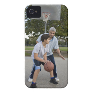 Hispanic father and son playing basketball iPhone 4 case