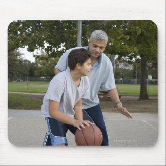 Hispanic father and son playing basketball mouse mat