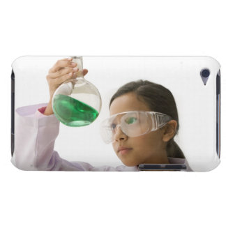 Hispanic girl looking at liquid in beaker iPod touch cover