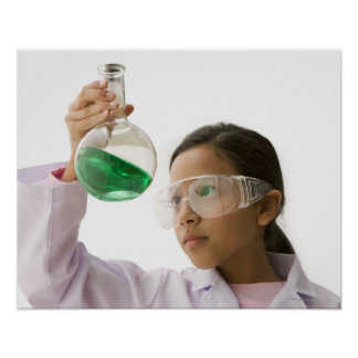 Hispanic girl looking at liquid in beaker poster