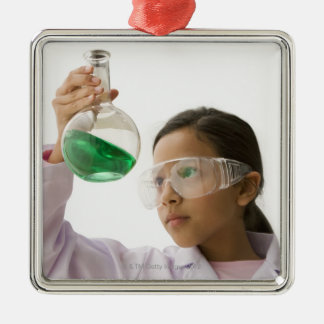 Hispanic girl looking at liquid in beaker Silver-Colored square decoration