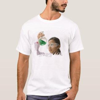 Hispanic girl looking at liquid in beaker T-Shirt