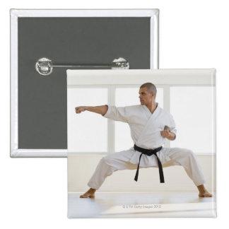 Hispanic male karate black belt in fighting 15 cm square badge