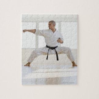 Hispanic male karate black belt in fighting jigsaw puzzle